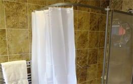 Shower water retension strip